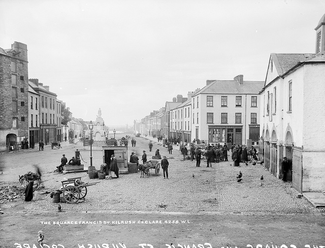a black and white photo depicting the square in Kilrush with local men and women pictured in Co. Clare, Ireland