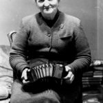 Mrs Elizabeth Crotty with her Lachenal concertina - an anglo concertina
