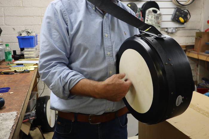 Paraic McNeela playing strapped bodhrán with hand