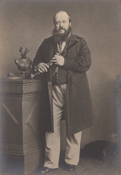 R. S. Pratten in sepia toned photograph from 1850s standing holding a flute