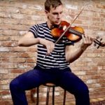 Liam O'Connor plays the Irish fiddle at McNeela Music Ireland