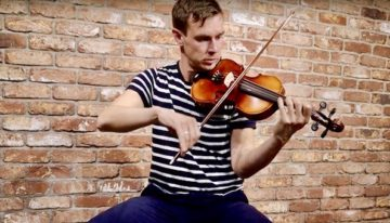 Liam O'Connor plays the Irish fiddle at McNeela Music Ireland - the bucks of Oranmore