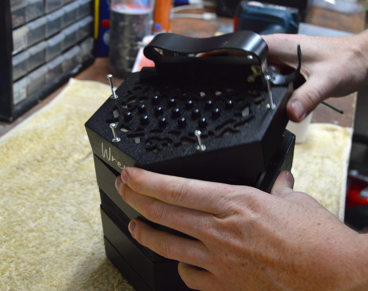 Lifting off a concertina end to fix a sticky button