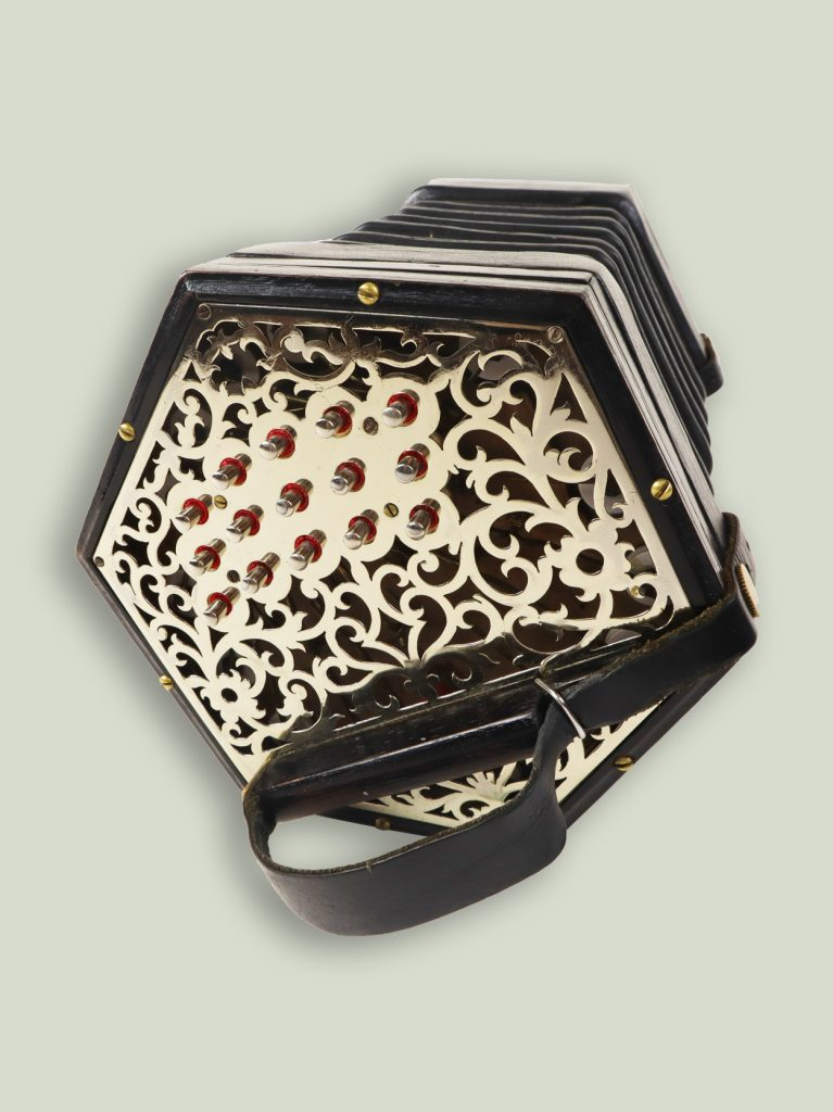 A 30 button anglo concertina showing 15 buttons on one side. Most Asked Questions about Concertinas