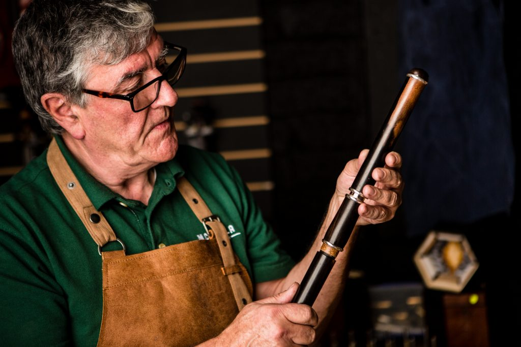 Paraic McNeela inspects one of his best Irish flutes in his workshop