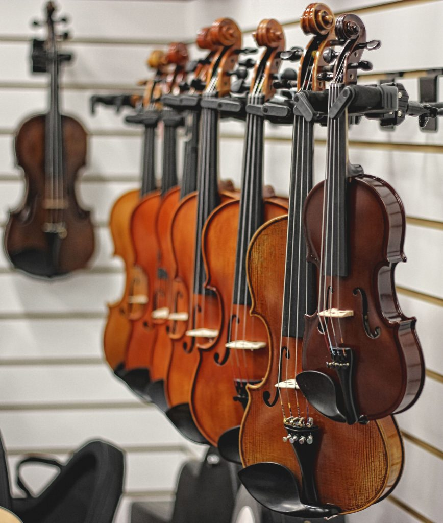 various sizes of Irish violin and fiddle