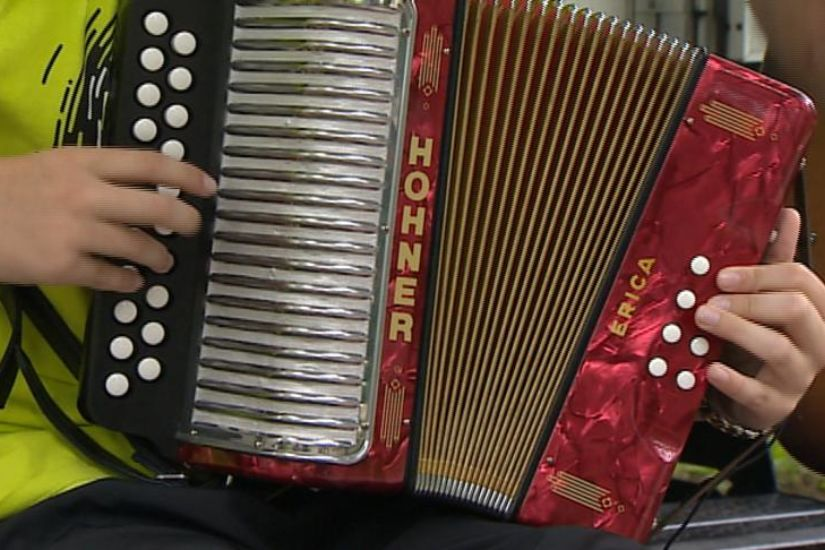 Beginner Student Accordion Player on Hohner Black Dot Double Ray