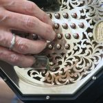 A concertina player playing a Wheatstone concertina - best beginner tunes for Irish concertina
