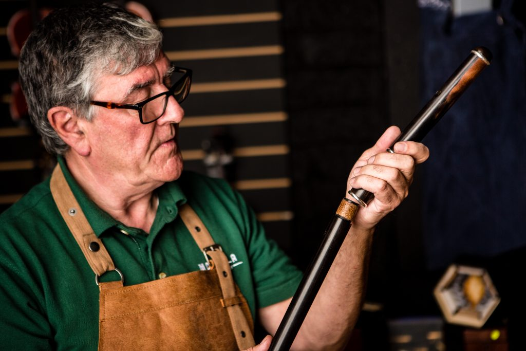 Paraic McNeela of McNeela Instruments inspects a newly made Irish wooden flute