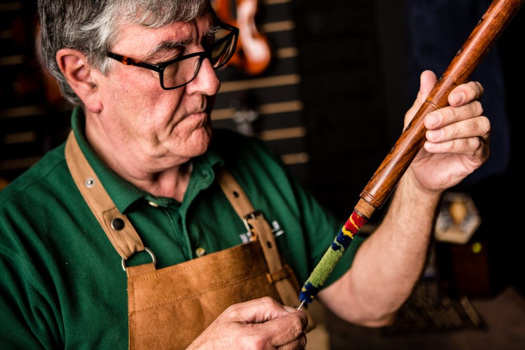 Paraic McNeela of McNeela Instruments cleans a newly made Irish wooden flute