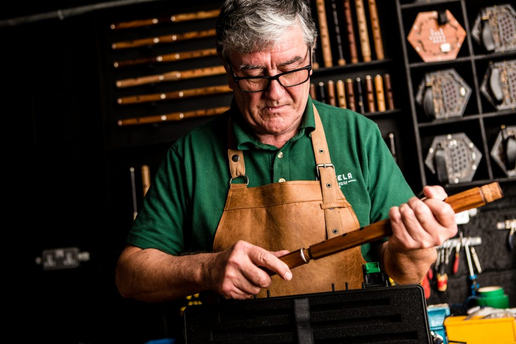 Paraic McNeela of McNeela Instruments assembles a newly made Irish wooden flute