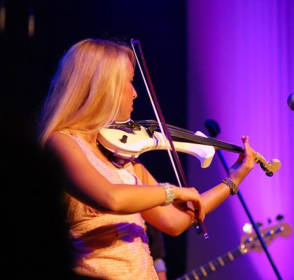 Performance on white electric violin